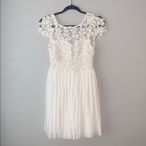 Flowy short sleeve white dress with lace top.